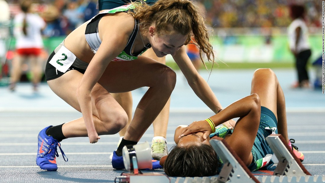 Teresinha de Jesus Correia Santos lies on the floor in tears after surprising the field to win and bronze medal, Brazil's fourth of the day.