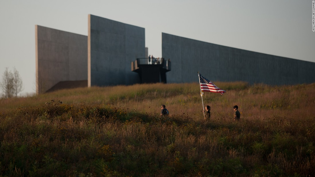 A US flag is carried through the fields at the Flight 93 National Memorial in Shanksville, Pennsylvania, before a luminaria service on September 10. The service was held to mark the 15th anniversary of American Airlines Flight 93 crashing into a field outside Shanksville with 40 passengers and four hijackers aboard, along with attacks on the World Trade Center and the Pentagon, on September 11, 2001.