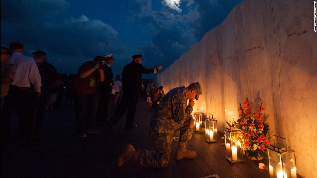 Pennsylvania National Guard Private Edward Noon, 22,   says a prayer during a luminaria service at the Flight 93 National Memorial on September 10 in Shanksville, Pennsylvania.