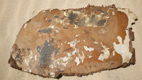 Debris piece with burn/scorch marks to both sides.