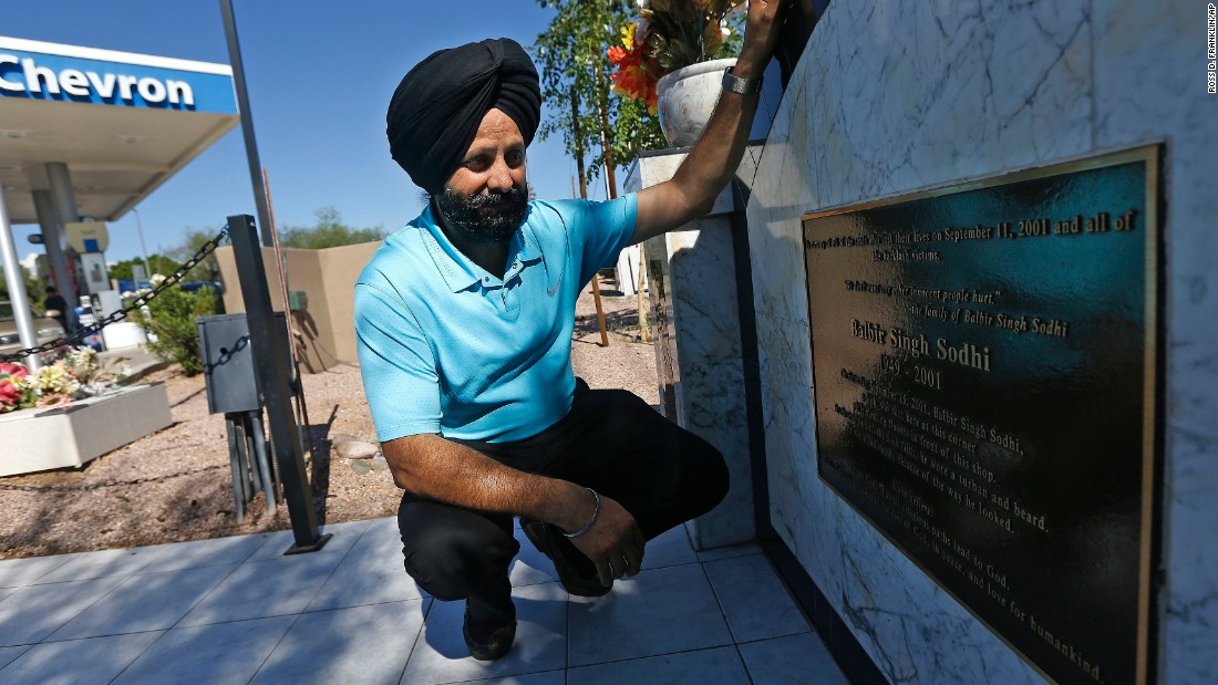 "The first victim of a revenge killing after the September 11, 2001, attacks was not a Muslim but a Sikh. Balbir Singh Sodhi was gunned down at the gas station he managed in Mesa, Arizona, by a man who wanted to kill ""towel heads."" Balbir's younger brother, Rana Singh Sodhi, kneels next to a memorial the family erected at the gas station. He became a voice for the Sikh community after his brother's murder."
