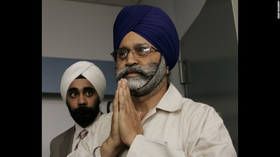 "Cab driver Rajinder Singh Khalsa, right, was beaten unconscious   in Richmond Hill, New York, by attackers who mocked his turban and yelled: ""Go back to your country."" Five men were convicted in the incident."