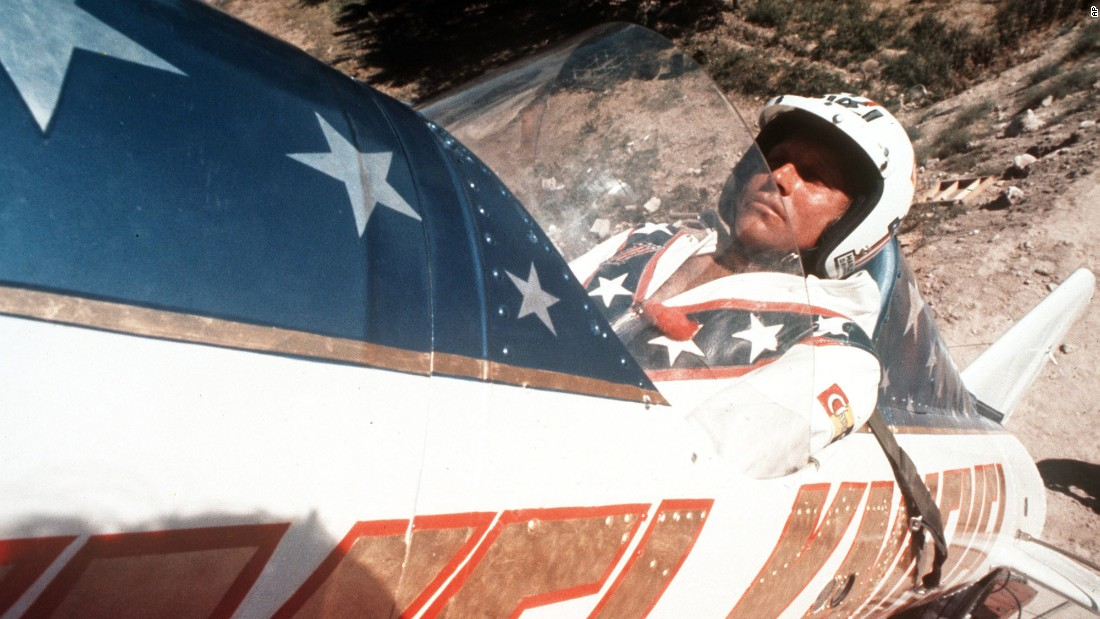 "Evel Knievel sits in his steam-powered ""rocket cycle"" before his September 8, 1974, attempt to jump the Snake River Canyon near Twin Falls, Idaho. (Note his lucky rabbit's foot.) Forty-two years later, Hollywood stuntman Eddie Braun plans to try the same jump, in a replica of Knievel's aircraft, to honor his daredevil hero."