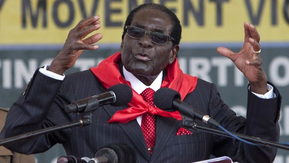 """Zimbabwean President Robert Mugabe delivers a speech on February 28, 2015 during the celebration of his 91st birthday in Victoria Falls. Mugabe celebrated his 91st birthday with a lavish million dollar bash that was slammed by the opposition as """"obscene"""" in a country wracked by poverty.The extravagance of Mugabe's birthday parties are a subject of annual controversy in Zimbabwe. AFP PHOTO / JEKESAI NJIKIZANA        (Photo credit should read JEKESAI NJIKIZANA/AFP/Getty Images)"""