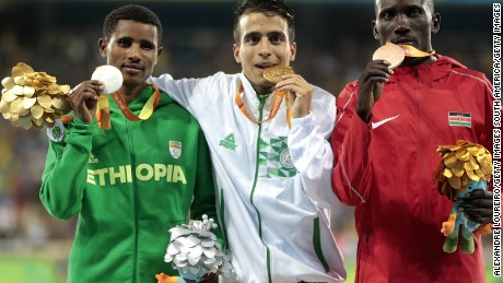Abdellatif Baka (center) won gold from Tamiru Demisse (left) and third-placed Henry Kirwa.