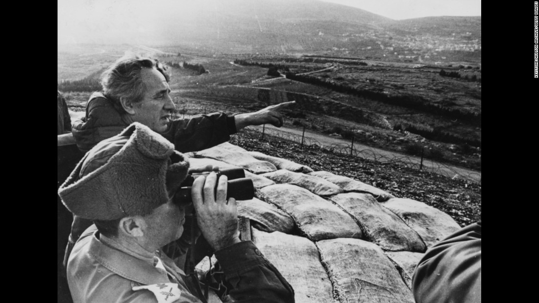 Peres, then Israel's Minister of Defense, pointing over Israel's northern border towards Lebanon during a tour of Lebanese border defenses on January 22, 1976.
