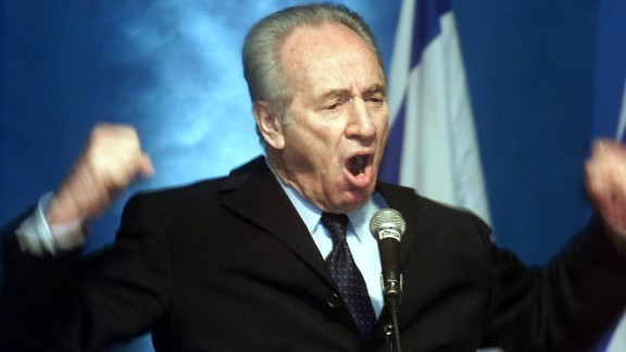 Former Israeli prime minister Shimon Peres makes a passionate plea for the Labor party to join a national unity government with the Likud party during a meeting of the party