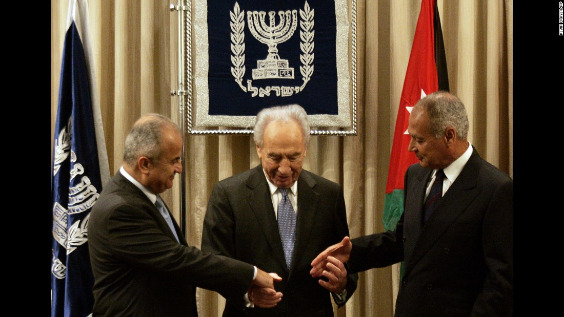 "Israeli President Shimon Peres, center, joins hands with Jordan's Foreign Minister Abdul-Ilah Khatib, left, and Egyptian Foreign Minister Ahmed Aboul Gheit during their meeting in Jerusalem on July 25, 2007.The foreign ministers of Egypt and Jordan made a historic visit to Israel to formally present an Arab peace plan, saying they were extending ""a hand of peace."""