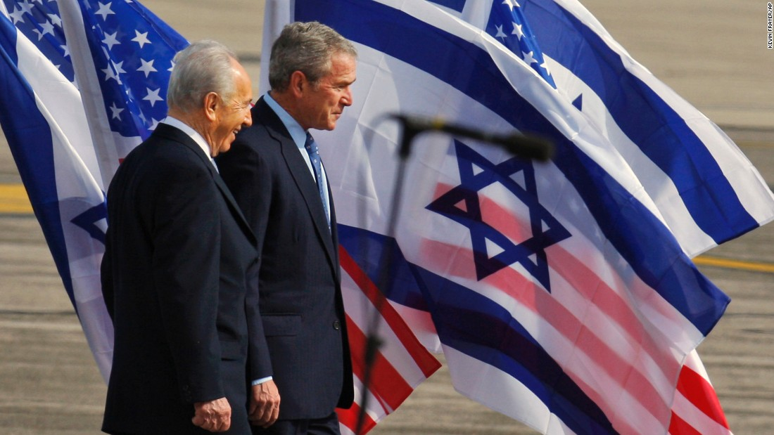 Israeli President Shimon Peres welcomes US President George W.  Bush upon his arrival at Ben-Gurion International Airport near Tel Aviv, Israel, on January 9, 2008.