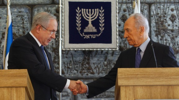 Israeli President Shimon Peres shakes hands with Likud Party leader Benjamin Netanyahu during their press conference in Jerusalem on February 20, 2009.  Peres gave the hawkish Netanyahu, who became Prime Minister the following month, formal permission to put together the country