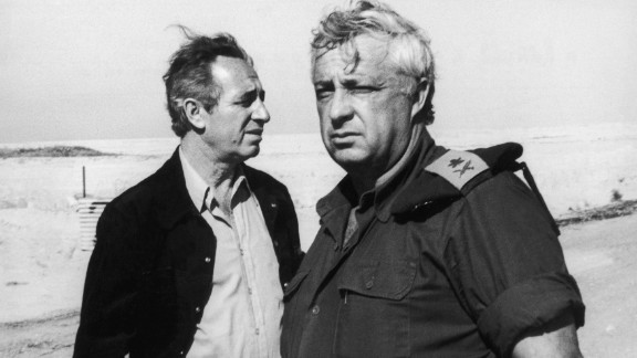 Peres, left, with then-Israel Defense Minister Ariel Sharon on January 2, 1974 in Ras Sudar in Egypt