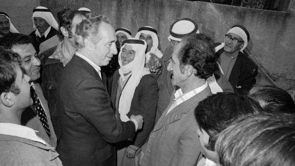 Defense Minister and acting Prime Minister Shimon Peres speaks with Israeli Arabs before Israelis go to the polls in Umm al-Fahm, Israel, on May 17, 1977 in the country