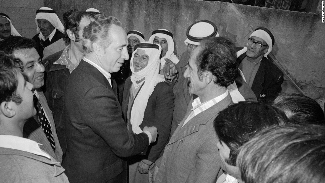 Defense Minister and acting Prime Minister Shimon Peres speaks with Israeli Arabs before Israelis go to the polls in Umm al-Fahm, Israel, on May 17, 1977 in the country's national elections.