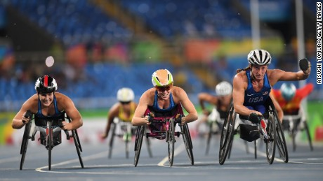 Left to right: Chelsea McClammer, Amanda McGrory and Tatyana McFadden celebrate winning silver, bronze and gold respectively in the T54 1500m.