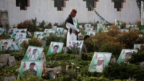 A man in Sanaa visits the grave of a relative killed in the conflict.