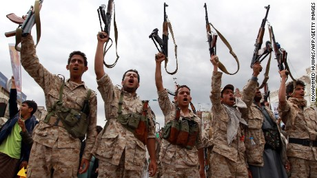 Men loyal to the Houthi movement brandish their weapons in March 2015 during a gathering in Sanaa.