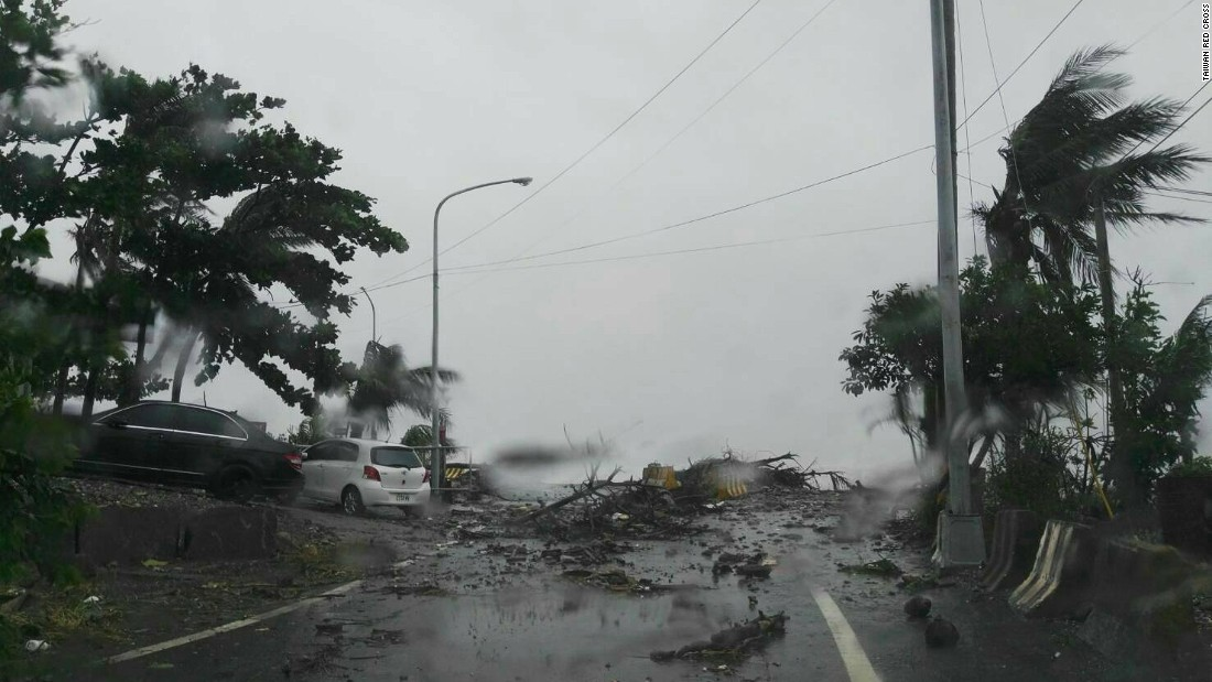 Roads blocked by fallen branches amid heavy winds and lashing rain in southern Taiwan.
