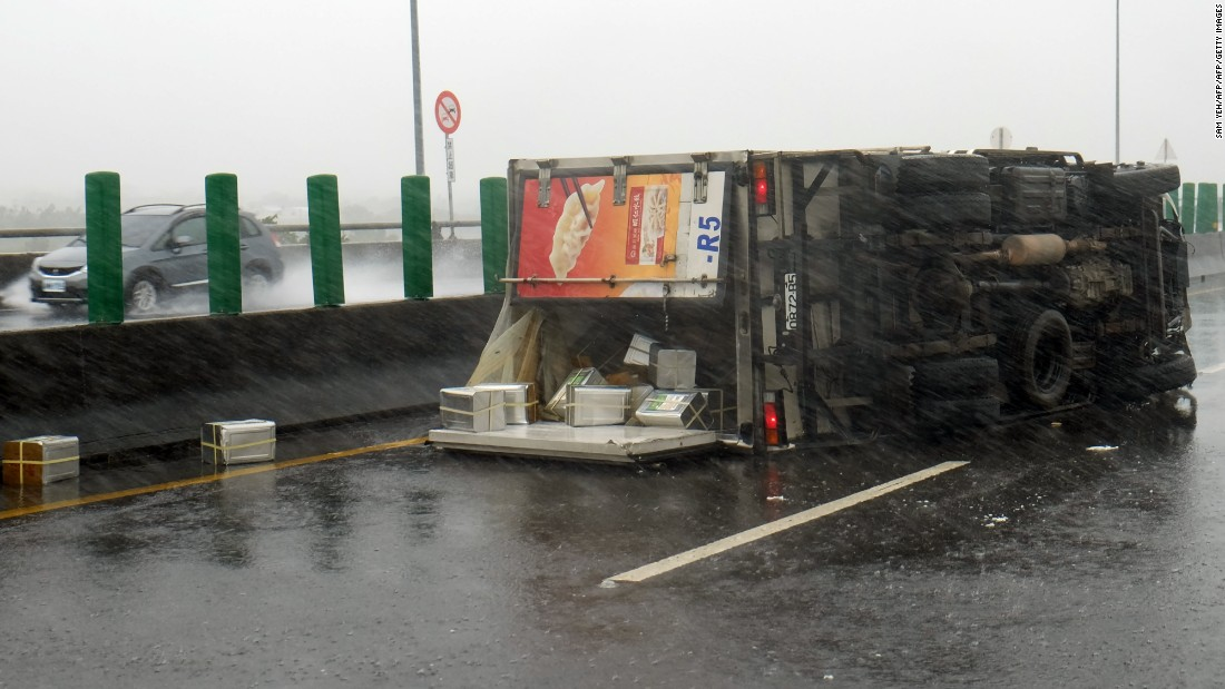 A truck is overturned in southern Pingtung county, Taiwan on September 14, 2016. The island is bracing for the impact of Super Typhoon Meranti.