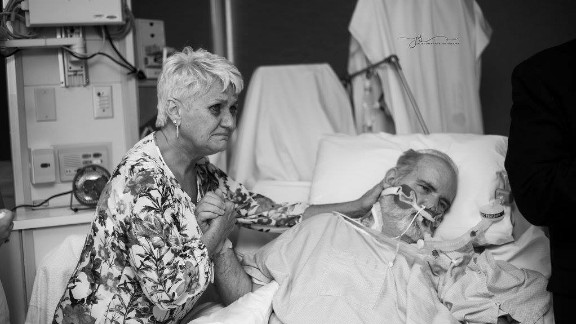Candice's mother, Teresa Hammonds, cares for her husband Steve in his hospital room.