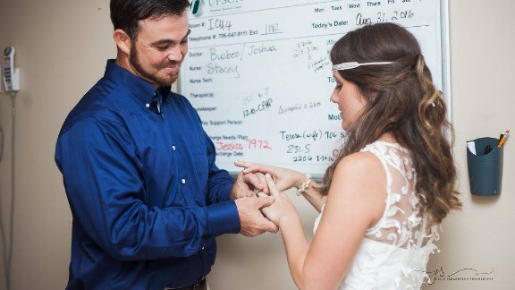 Candice Hammonds and Thomas Burkett exhange vows and rings.
