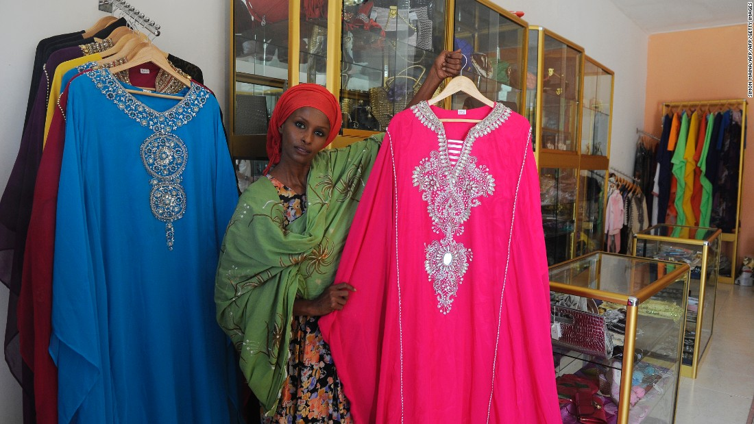 Ayan Hussein, a London stylist originally from Somaliland, shows dresses she sells to local Muslim women, inside her clothing store in Hargeisa. Hussein is one of many immigrants who have found their way back to the relative calm of Somaliland.