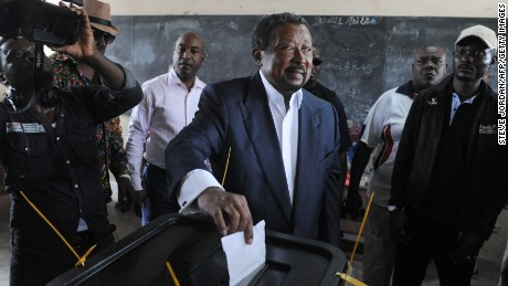 Presidential candidate Jean Ping casts his ballot at the Martine Oulabou school in Libreville during Gabon's presidential election on August 27, 2016.