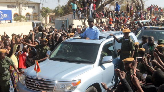 The presidential candidate Edgar Lungu of Zambia's ruling party Patriotic Front waves to the crowd as he arrives to cast his ballot on the day of the election. He was sworn in earlier this month for another five years.