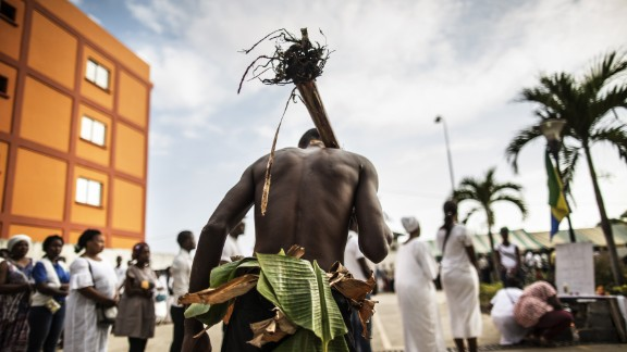 The unrest resulted in deadly violence, arrests and media black outs. Here, a man traditionally dressed with banana leaves joins mourners paying their respects at an altar for those who died.