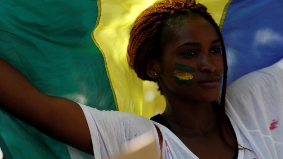 The results, released  August 31, show that Bongo won 49.8% of the vote, while Jean Ping, the opposition leader, had 48.23%. Ping and his supporters say the numbers are fraudulent and demand a recount. This sparked protests in France too. Pictured here, a woman waves a Gabonese flag during a demonstration in Paris in September.