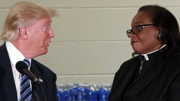 Rev. Faith Green Timmons interrupts Republican presidential candidate Donald Trump as he spoke during a visit to Bethel United Methodist Church, Wednesday, Sept. 14, 2016, in Flint, Mich. Timmons asked that Trump not deliver a political speech, and keep his message to the people of Flint. (AP Photo/Evan Vucci)