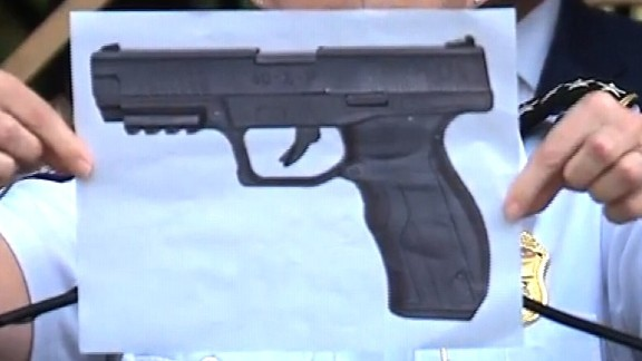 Columbus police Chief Kim Jacobs holds up a picture of what she says is a BB gun like Tyre King