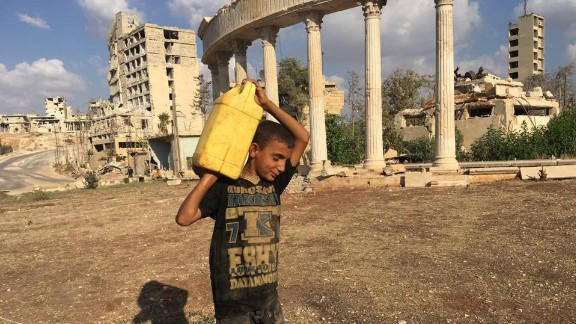A child carrying a canister filled with water near Castello road in Aleppo.
