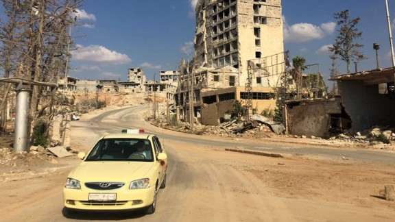 A taxi driving out of a formally rebel controlled area near Castello road in Aleppo.