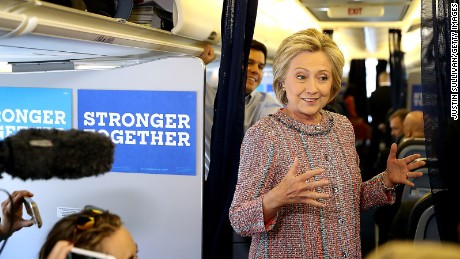 Hillary Clinton speaks to members of the traveling press aboard her campaign plane at Westchester County Airport on September 15, 2016 in White Plains, New York.