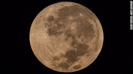 Photographer Greg Hogan captured this image of a harvest moon early Friday in Kathleen, Georgia.