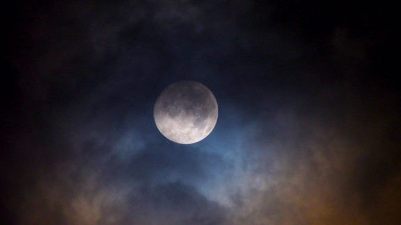 Doucet found the moon took on different hues throughout Friday evening.