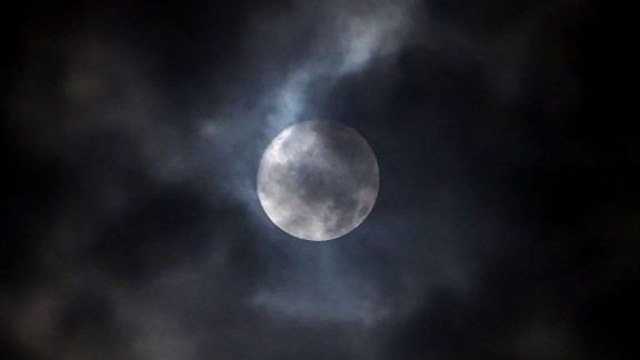 Across the globe in Kobe, Japan, Dennis Doucet saw the harvest moon, somewhat obscured by clouds.