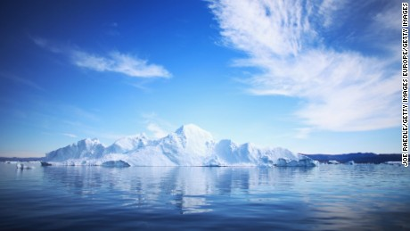 ILULISSAT, GREENLAND - JULY 20:  An iceberg floats through the water on July 20, 2013 in Ilulissat, Greenland. As Greenlanders adapt to the changing climate and go on with their lives, researchers from the National Science Foundation and other organizations are studying the phenomena of the melting glaciers and its long-term ramifications for the rest of the world. In recent years, sea level rise in places such as Miami Beach has led to increased street flooding and prompted leaders such as New York City Mayor Michael Bloomberg to propose a $19.5 billion plan to boost the citys capacity to withstand future extreme weather events by, among other things, devising mechanisms to withstand flooding.  (Photo by Joe Raedle/Getty Images) (Photo by Joe Raedle/Getty Images)