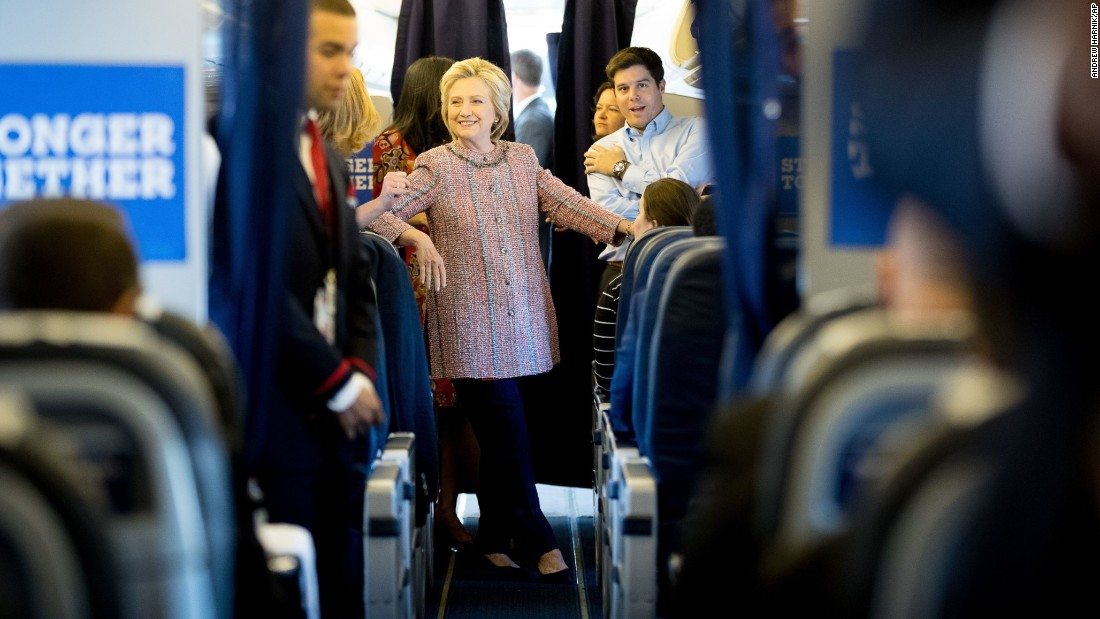 "Democratic presidential nominee Hillary Clinton speaks to aides on her campaign plane in White Plains, New York, on Thursday, September 15. Clinton <a href=""http://www.cnn.com/2016/09/16/politics/hillary-clinton-obama-birther-pneumonia/index.html"" target=""_blank"">returned to the campaign trail</a> after a bout of pneumonia sidelined her for three days."