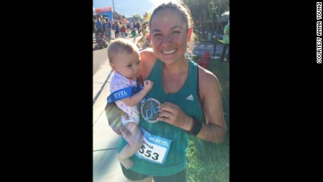 Anna Young celebrates with her 5-month-old daugher after finishing a half Marathon