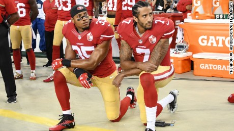 Colin Kaepernick, right, and Eric Reid of the San Francisco 49ers kneel in protest during the national anthem prior to a game against the Los Angeles Rams on September 12.