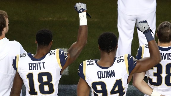 Kenny Britt and Robert Quinn of the Los Angeles Rams raise their fists prior to playing the San Francisco 49ers on September 12, 2016, in Santa Clara.