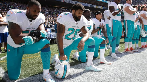 From left, Miami Dolphins