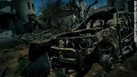 The remains of a former ISIS car after it was hit by a US airstrike, which began on August 1.