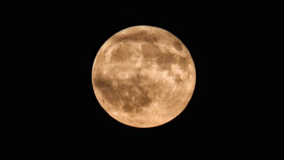 """""""With a beautiful full moon that was glowing orange on a clear night, I had to take advantage and get some photos,"""" Faith Konidaris of Pittsburgh says."""