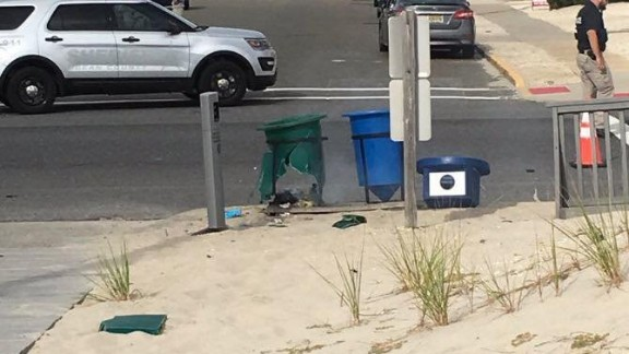 An explosive damaged this green garbage can on the morning of Saturday, September 17, 2016. The can was along what was to be the route for a Marine Corps charity run in Seaside Park, New Jersey, the Ocean County prosecutor's office said.