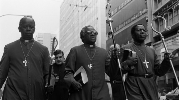 Tutu, center, leads clergymen through Johannesburg in April 1985. They were heading to police headquarters to hand a petition calling for the release of political detainees.
