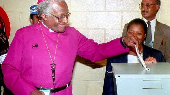 """Tutu casts his vote in South Africa's first election that allowed citizens of all races to vote. """"You just want to yell, dance, jump and cry all at the same time,"""" he said."""