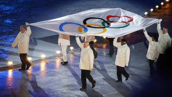 Tutu and other dignitaries escort the Olympic flag during the opening ceremony of the 2002 Winter Olympics in Salt Lake City.
