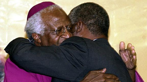 Tutu hugs South African President Thabo Mbeki after turning over the Truth and Reconciliation Report in 2003. Tutu chaired the commission that produced the report.